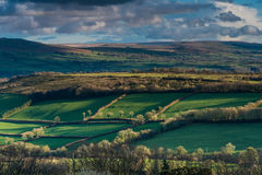 Panoramic landscape, rolling hills and cloudy sky Royalty Free Stock Image