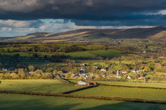 Panoramic landscape, rolling hills and cloudy sky Royalty Free Stock Photography
