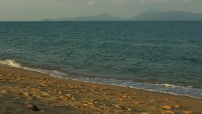Panoramic landscape with sea waves at the beach in the evening stock footage