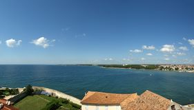 Panoramic landscape with the sky, the sea and roof Stock Photography