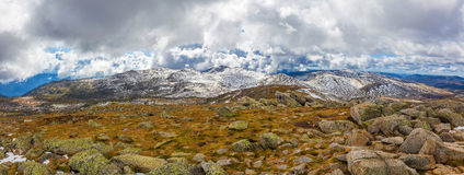 Panoramic landscape of snow covered peaks of Australian Alps und. Er beautiful clouds. New South Wales, Australia Royalty Free Stock Photography