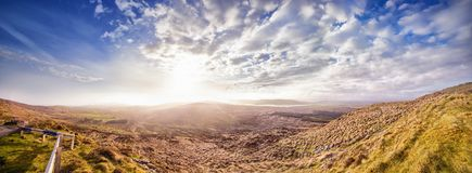 Panoramic landscape with sunny sunset in a county Kerry. Ireland Royalty Free Stock Photos