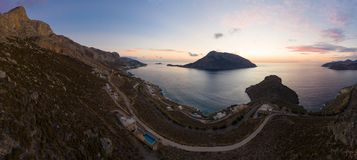 Panoramic landscape of Telendos island in distance and part of Kalymnos island at sunset stock photos
