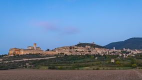 Panoramic landscape timelapse. Assisi Italy Basilica of St. Francis  sunset to night. Sunset amazing view