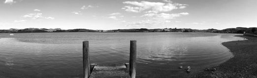 Panoramic landscape view of an empty wooden pier in New Zealand Royalty Free Stock Images