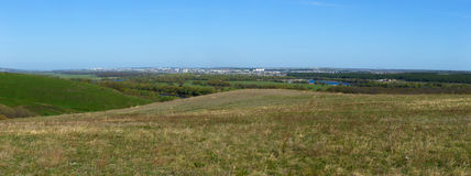 Panoramic landscape. View from  hills to the city outskirts. Royalty Free Stock Photography