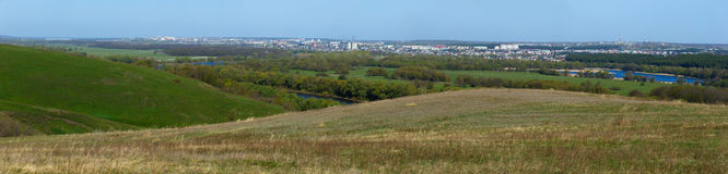 Panoramic landscape. View from  hills to the city outskirts. Royalty Free Stock Images