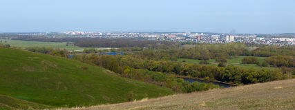 Panoramic landscape. View from  hills to the city outskirts. Royalty Free Stock Photo