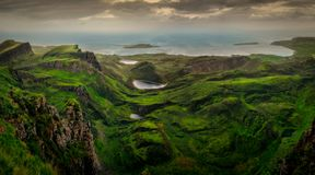 Panoramic landscape view of Quiraing coastline in Scottish highlands, Scotland, UK. Panoramic landscape view of Quiraing coastline in Scottish highlands, Isle of stock photos