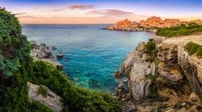 Panoramic landscape view at rocky ocean coastline. Capo Testa, Sardinia, Italy Royalty Free Stock Photos