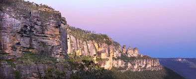 Panoramic landscape view of The Three Sisters rock formation in. The Blue Mountains of  South Wales, Australia, on the north escarpment of the Jamison Valley Royalty Free Stock Photos