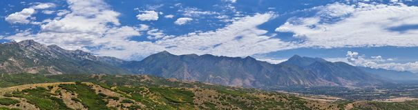 Panoramic Landscape view from Travers Mountain of Provo, Utah County, Utah Lake and Wasatch Front Rocky Mountains, and Cloudscape. Utah, USA stock photos