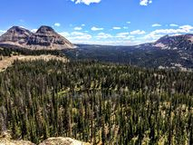 Panoramic Landscape View of Uinta Mountains, clouds, lakes and forest, Utah, USA, America West. Ern Wild, Remote Backpacking Area close to Hayden`s Peak and Stock Photos