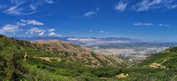 Panoramic Landscape view of Wasatch Front Rocky and Oquirrh Mountains, Rio Tinto Bingham Copper Mine, Great Salt Lake Valley in su royalty free stock image
