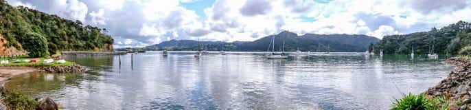 Panoramic landscape view of Whangaroa Harbour, Northland, New Ze. Panoramic landscape view of anchored boats at Whangaroa Harbour, Northland, New Zealand, NZ Stock Photos