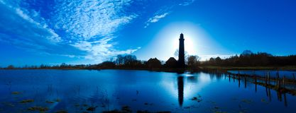 Panoramic landscpae with Lighthouse in contre jour twilight royalty free stock photo