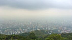 Panoramic lateral movement of cloudy city