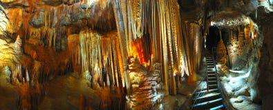 Panoramic of limestone stalagmites and stalactite, jenolan caves. Panoramic of amazing limestone stalacmite and stalactite formations deep underground at Jenolan royalty free stock photography