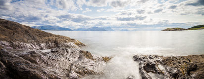 Panoramic long exposure shot of the sea with rocks in Northern N Stock Image