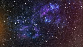 Panoramic looking into deep space. Dark night sky full of stars. The nebula in outer space. Royalty Free Stock Image