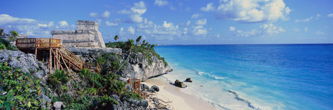 A Panoramic of Mayan ruins of Ruinas de Tulum (Tulum Ruins) and El Castillo at sunset, with beach and Caribbean Sea, in Quintana R Stock Photo