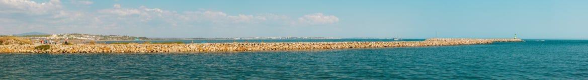 Panoramic Meia praia, Half beach, pier / harbour entrance, Lagos stock photography