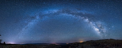 Panoramic milky way over bryce canyon. Panoramic view of the milky way over the bryce canyon national park from sagitarius to perseus royalty free stock photography