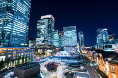 Panoramic modern city skyline bird eye aerial night view with tokyo station under dramatic glow and beautiful dark blue sky in To. Business concept for real royalty free stock photo