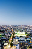 Panoramic modern city skyline bird eye aerial night view under dramatic neon glow and beautiful dark blue sky in Tokyo, Japan Royalty Free Stock Photo