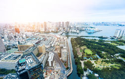 Panoramic modern city skyline bird eye aerial view of Odaiba bay and bridge under dramatic sunrise and morning blue cloudy sky in Royalty Free Stock Image