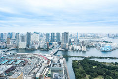 Panoramic modern city skyline bird eye aerial view of Odaiba bay and bridge under dramatic sunrise and morning blue cloudy sky in Royalty Free Stock Photography