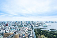 Panoramic modern city skyline bird eye aerial view of Odaiba bay and bridge under dramatic sunrise and morning blue cloudy sky in Stock Photography