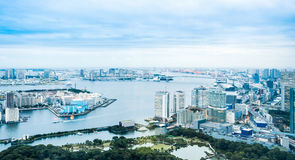 Panoramic modern city skyline bird eye aerial view of Odaiba bay and bridge under dramatic sunrise and morning blue cloudy sky in Stock Images