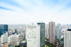 Panoramic modern city skyline bird eye aerial view under dramatic sun and morning blue cloudy sky in Tokyo, Japan Stock Photo