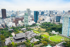 Panoramic modern city skyline bird eye aerial view with zojo-ji temple shrine from tokyo tower under dramatic sunrise and morning. Business and culture concept Royalty Free Stock Photography