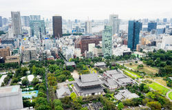 Panoramic modern city skyline bird eye aerial view with zojo-ji temple shrine from tokyo tower under dramatic sunrise and morning. Business and culture concept Stock Photo