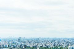 Panoramic modern city urban skyline bird eye aerial view under sun & blue sky in Tokyo, Japan. Asia Business concept for real estate and corporate construction royalty free stock photography