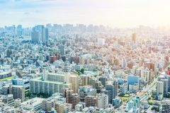 Panoramic modern city urban skyline bird eye aerial view under sun & blue sky in Tokyo, Japan. Asia Business concept for real estate and corporate construction royalty free stock photo