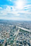 Panoramic modern city urban skyline bird eye aerial view under sun & blue sky in Tokyo, Japan. Asia Business concept for real estate and corporate construction stock images