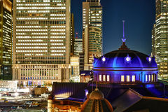 Panoramic modern cityscape building bird eye aerial night view of Tokyo Station under neon light and dark blue sky in Tokyo, Japan Stock Photos