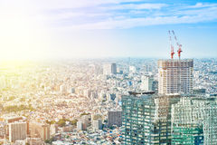 Panoramic modern cityscape building bird eye aerial view and cranes under sunrise and morning blue bright sky in Tokyo, Japan Royalty Free Stock Photography
