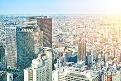 Panoramic modern cityscape building bird eye aerial view and cranes under sunrise and morning blue bright sky in Tokyo, Japan Royalty Free Stock Photo