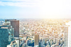 Panoramic modern cityscape building bird eye aerial view and cranes under sunrise and morning blue bright sky in Tokyo, Japan Royalty Free Stock Images