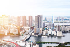 Panoramic modern cityscape building bird eye aerial view of Odaiba bay and rainbow bridge under sunrise and morning blue bright sk Royalty Free Stock Photos