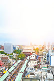 Panoramic modern cityscape building bird eye aerial view of Sensoji shrine under sunrise and morning blue bright sky in Tokyo, Royalty Free Stock Images