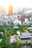 Panoramic modern cityscape building bird eye aerial view with zojo-ji temple shrine from tokyo tower under sunrise and morning blu stock image