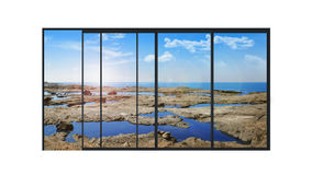 Panoramic modern window with a stones and sea landscape Royalty Free Stock Photos