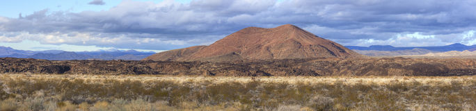 Panoramic Mojave Desert and cinder cone volcano Stock Images
