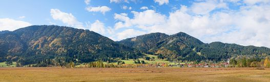 Panoramic moor landscape with spa town unterammergau. Panoramic autumnal moor landscape with town unterammergau in the bavarian alps royalty free stock image