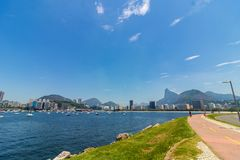 Panoramic morning view of the beach and Botafogo cove with its buildings, boats and mountains in Rio de Janeiro. Panoramic morning view of the beach and Botafogo royalty free stock images